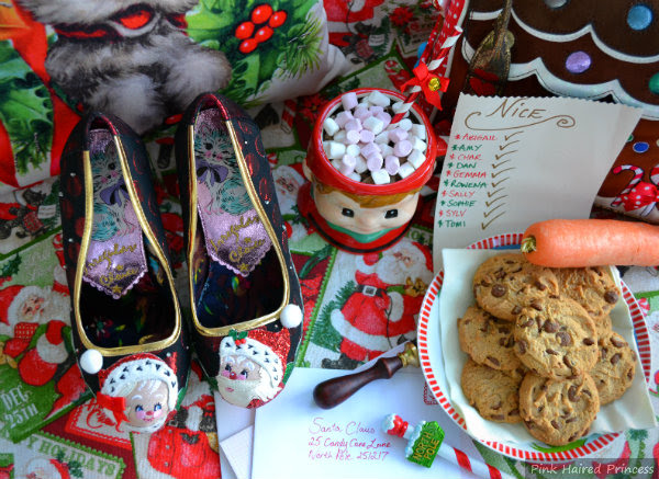 Mr & Mrs Claus applique shoes in Christmas scene with plate of cookies and carrot