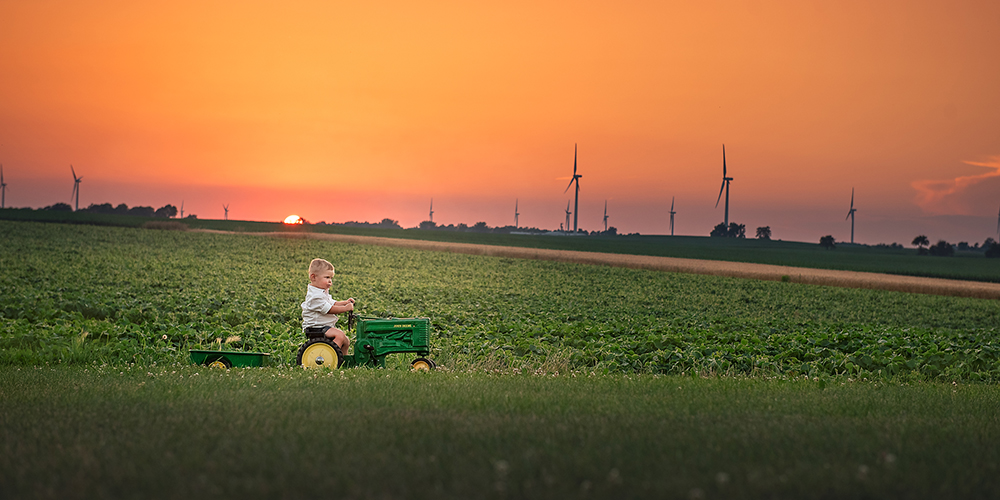toddler on a john deere tractor at sunset Shabbona IL DeKalb IL best child photographer