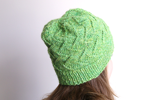 Wearing Knitted Irma Hat in Green Handspun Wool Yarn
