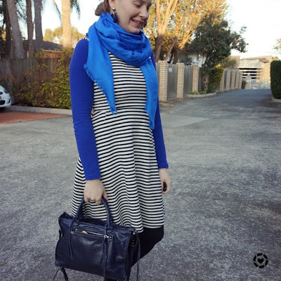 awayfromblue instagram | cobalt tee, striped fit and flare dress colourful winter office outfit