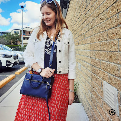 awayfromblue Instagram | white denim jacket with navy embroidered tunic, red printed maxi skirt and navy micro bedford bag