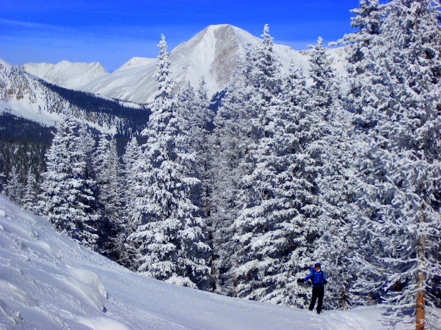 """We thought we might have a tough decision about where to start our backcountry snowboarding adventures. I guess you could say that narrowing it down to the western mountains of North America wasn't entirely helpful. <br /><br /><table align=""""center"""" cellpadding=""""0"""" cellspacing=""""0""""><tbody><tr><td><a href=""""https://3.bp.blogspot.com/-gM6zQpAS9Hg/Vri8SW4TvdI/AAAAAAAAQDA/O0ozUkGrlII/s1600/IMG_0174.JPG""""><img border=""""0"""" height=""""480"""" src=""""https://3.bp.blogspot.com/-gM6zQpAS9Hg/Vri8SW4TvdI/AAAAAAAAQDA/O0ozUkGrlII/s640/IMG_0174.JPG"""" width=""""640""""/></a></td></tr><tr><td>All smiles in the backcountry near Leadville atop Gold Hill.<br />Strong winds whipping the snow off the mountains in the background</td></tr></tbody></table><br /><br />Our friends, Melissa and Dave, made it easy to decide where to start. They are renting a house in Leadville, Colorado for the winter/spring and generously invited us to stay and explore the area around them. What started out as an innocent weekend in Leadville, turned into a 3-week stay, with a side trip a couple hours south. <br /><br /><table align=""""center"""" cellpadding=""""0"""" cellspacing=""""0""""><tbody><tr><td><a href=""""https://1.bp.blogspot.com/-hDyXru2ENU4/Vri809oMImI/AAAAAAAAQDE/yRwJx8zzF24/s1600/DSC09942%2B%2528Large%2529.JPG""""><img border=""""0"""" height=""""426"""" src=""""https://1.bp.blogspot.com/-hDyXru2ENU4/Vri809oMImI/AAAAAAAAQDE/yRwJx8zzF24/s640/DSC09942%2B%2528Large%2529.JPG"""" width=""""640""""/></a></td></tr><tr><td>Hanging out at the local brewpub called Pb (""""Periodic Brewing"""" and also the chemical element symbol for Lead - get it?)</td></tr></tbody></table><br />Leadville is the highest city in the USA, situated at 10,200 feet above sea level in the Colorado Rockies. It is a tiny town with an interesting contrast of gun-toting, big-truck-driving folks and outdoorsy, fitness enthusiasts. It also happens to be incredibly mellow and laid back - perfect. The cold, dry air up there is no joke. We woke up with bloody noses for a week, before our bodies acclimated."""
