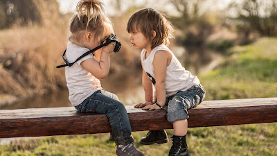 little-child-taking-photograph-of-other-baby