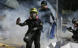 New clashes erupt in Hong Kong university; police fire tear gas,protesters hurl Gas bomb