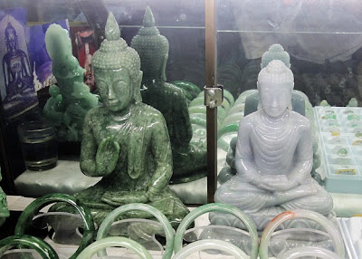 Buddha statues for sale at a market shop