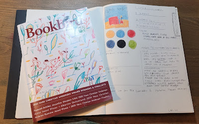 """Image of sketchbook with handwritten notes analyzing the book Little Bird by Germano Zullo, illustrated by Albertine. On top of the notebook rests an issue of Bookbird journal. Listed on the cover is """"2020 Hans Christian Anderson Award Winners"""