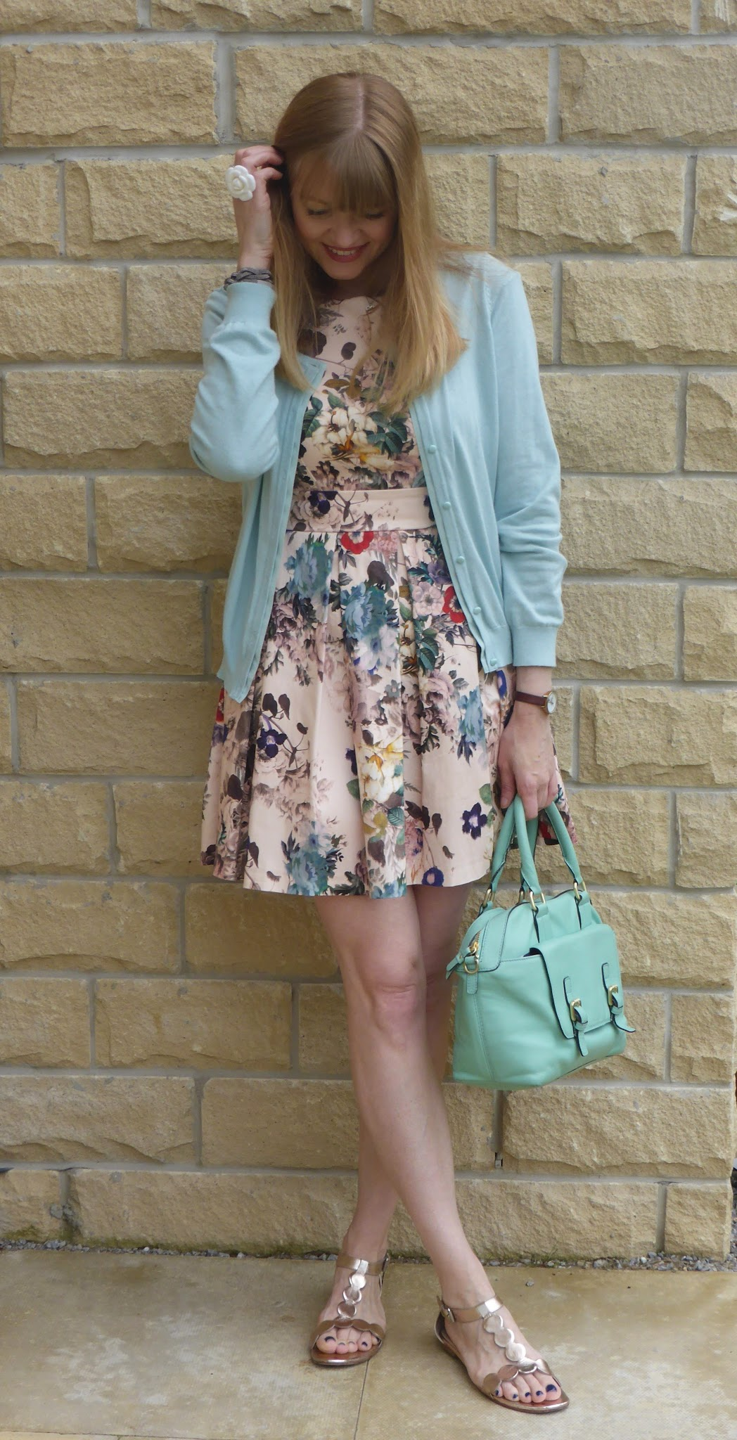 Over 40s blogger What Lizzy Loves wears floral skater dress with rose gold sandals and cardigan