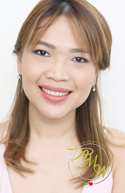 a photo of askmewhats wearing L'Oreal Infallible Pro Matte Gloss