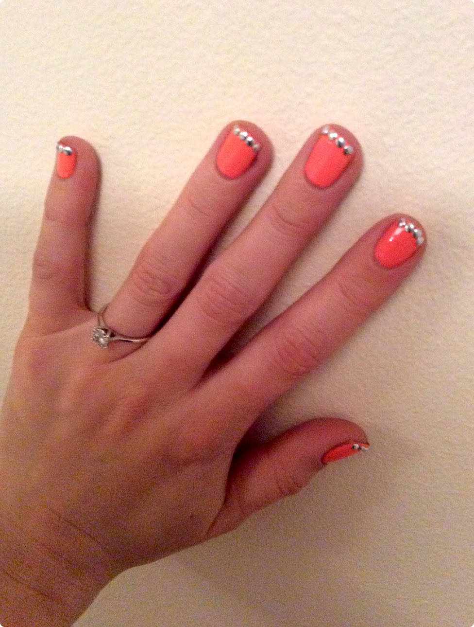 Alternative french manicure with studs and gems