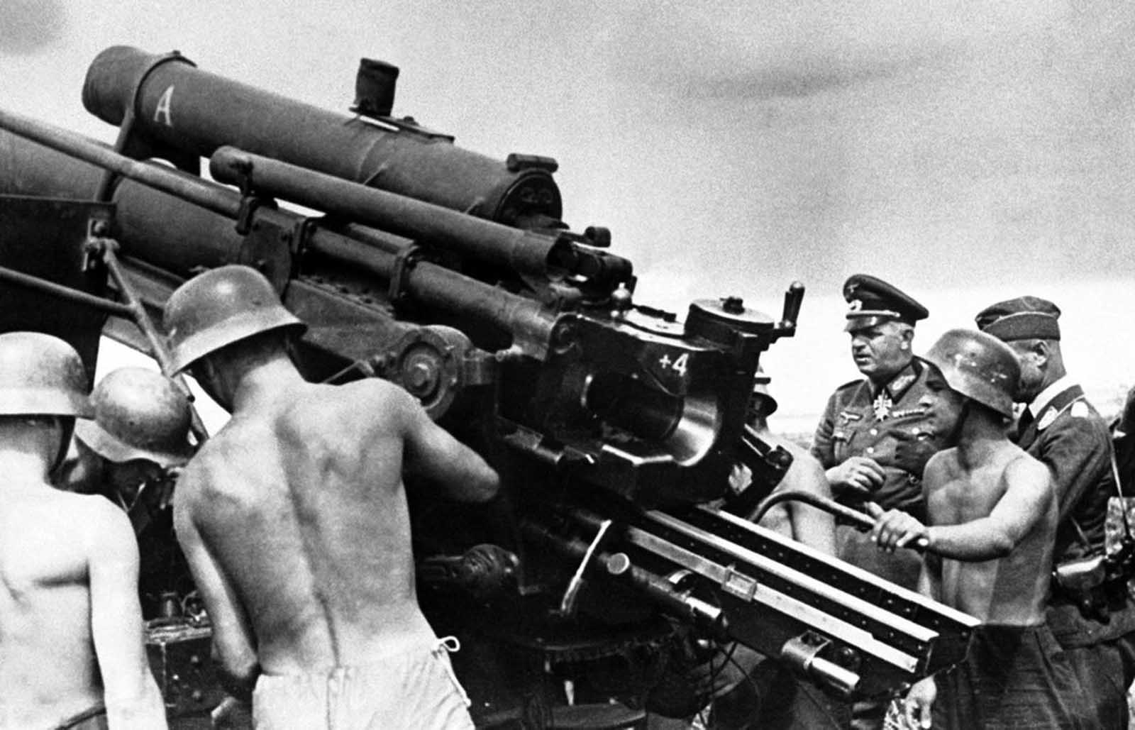 German Army Commander Colonel General Ernst Busch inspects an anti-aircraft gun position, somewhere in Germany, on Sept. 3, 1941.