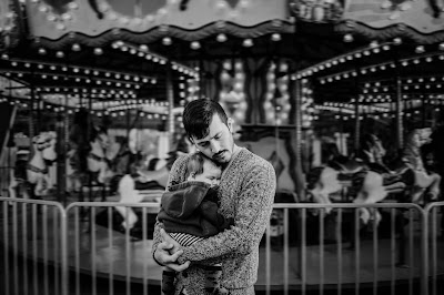 Father and Daughter in front of a carousel black and white portrait by Morning Owl Fine Art Photography