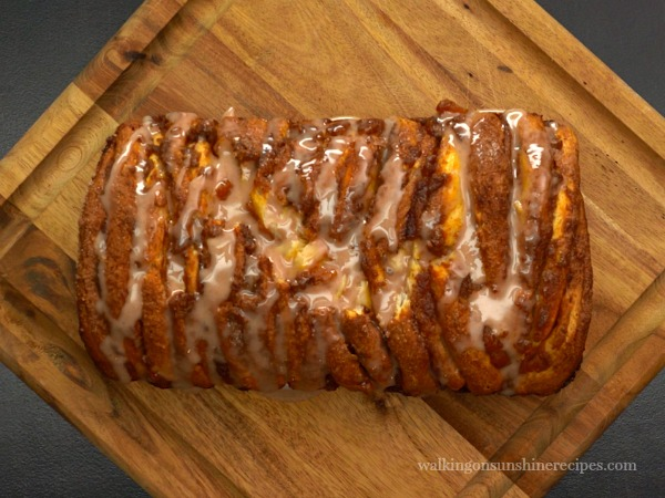 Drizzle the glaze on top of the slightly cooled Pumpkin Spice Pull-Apart Bread from Walking on Sunshine Recipes.