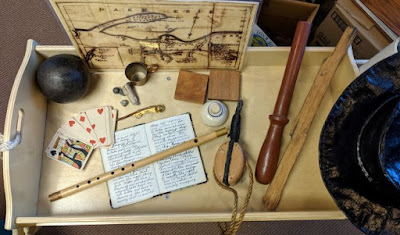 Map, flute, playing cards, cannonball, journal, other repro ship items