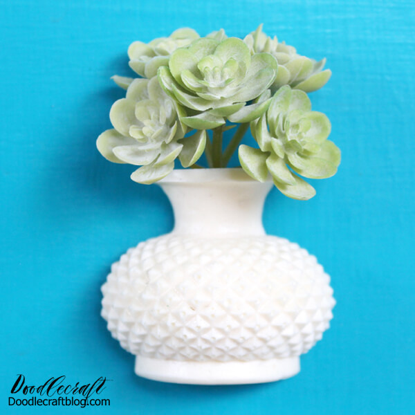 Make a cute succulent vase magnet with FastCast resin, a little faux succulent and a disc magnet, perfect for a fridge or locker ornament.  I love filling my fridge with wedding invitations, cards, kids artwork and more…most days my fridge looks completely cluttered.