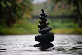 Stacked rocks on top of water