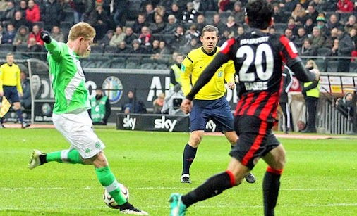 Wolfsburg claimed a 2-1 win over Hertha Berlin Bas Dost scored his eighth and ninth goals of 2015 as...