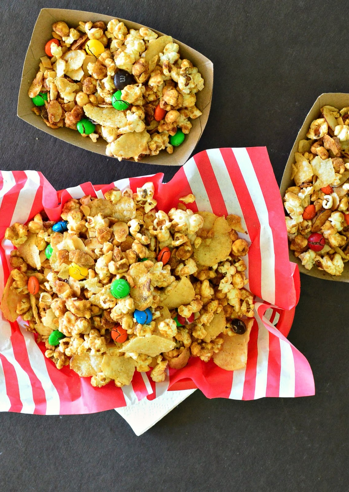 Popcorn with a chipotle caramel glaze and potato chips and almonds and m and m's! #caramelcorn #snackfood #popcorn www.thisishowicook.com