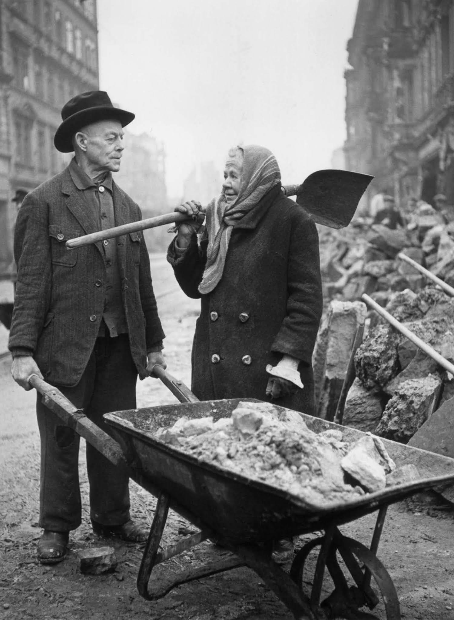 Gustav and Alma Piltz help clear rubble. 1946.