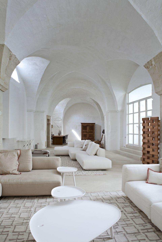 Un antiguo molino de aceite convertido en la casa de vacaciones de dos arquitectos italianos