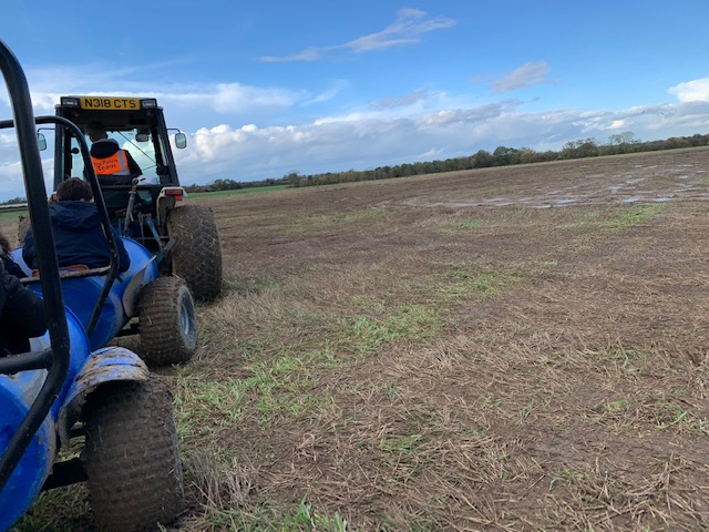 Barrel tractor ride in a field