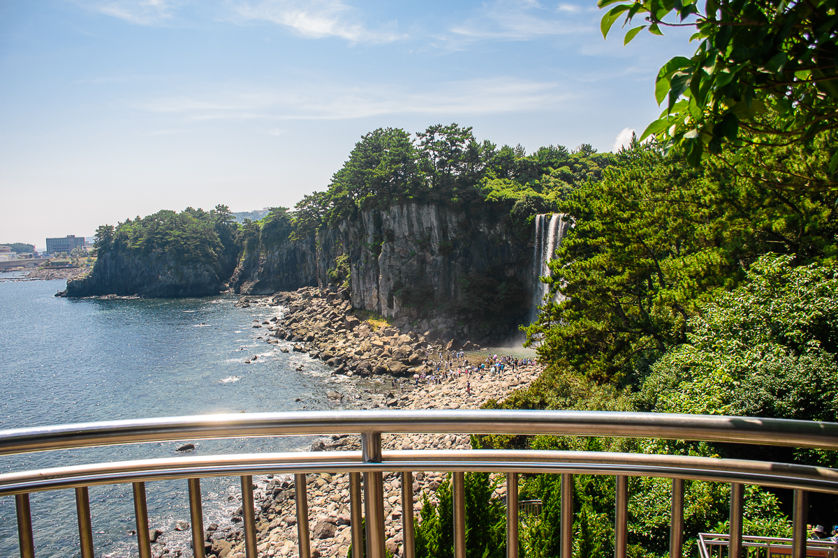 jeonbang waterfall in jeju waterfall and lava rocks