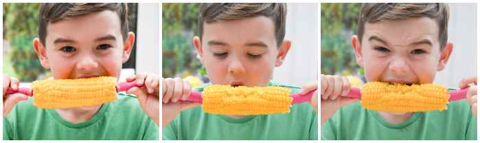 child messily eating corn on the cob