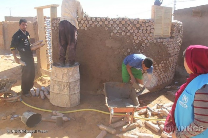 Tateh Lehbib builds homes from recycled plastic bottles and filled with sand and straw.