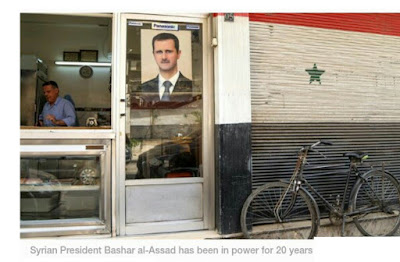 Syria conducts parliamentary elections as President Bashar al-Assad marks 20 years in power amid a continuing war and deep economic woes