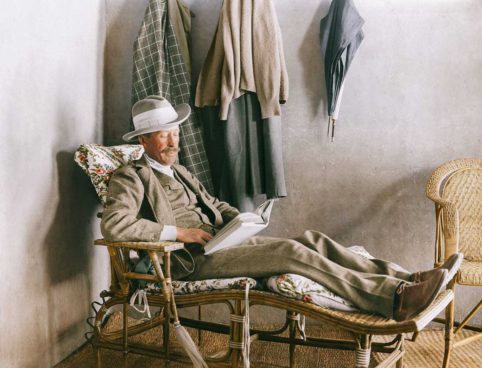Lord Carnarvon, financier of the excavation, reads on the veranda of Carter's house near the Valley of the Kings.