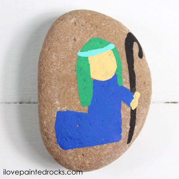 Painting a Shepherd on a rock for the perfect Nativity Set of painted rocks