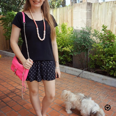 awayfromtheblue instagram | monochrome black tee and printed shorts summer outfit with Rebecca Minkoff neon pink mini MAC
