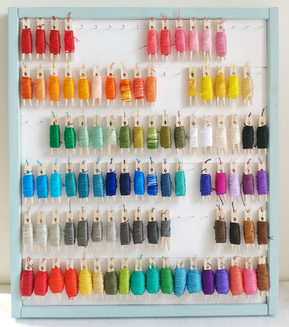 DIY storage for embroidery floss wrapped on clothespins