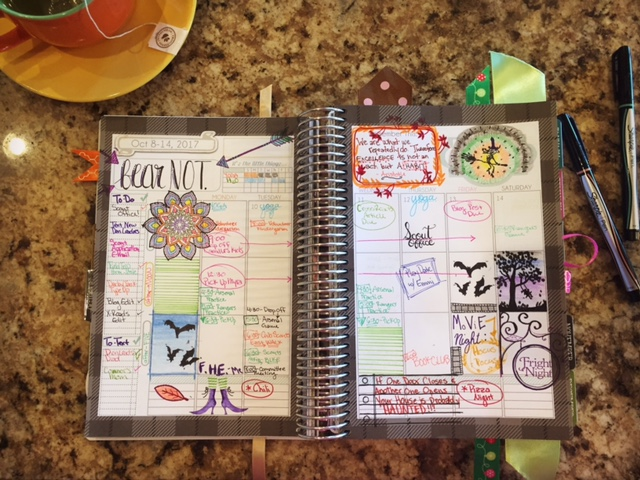 cute October planner filled out with Halloween stickers, witch and bat drawings Mormon Mom Planner
