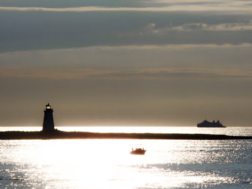The Fayerweather Lighthouse in Bridgeport CT.  With the Port Jefferson - Bridgeport Ferry beyond.