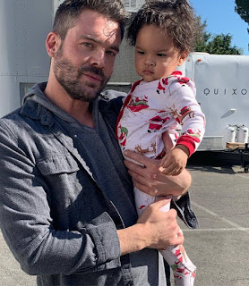 Picture of Charlie Weber carrying a kid