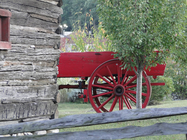 red wagon parked by barn