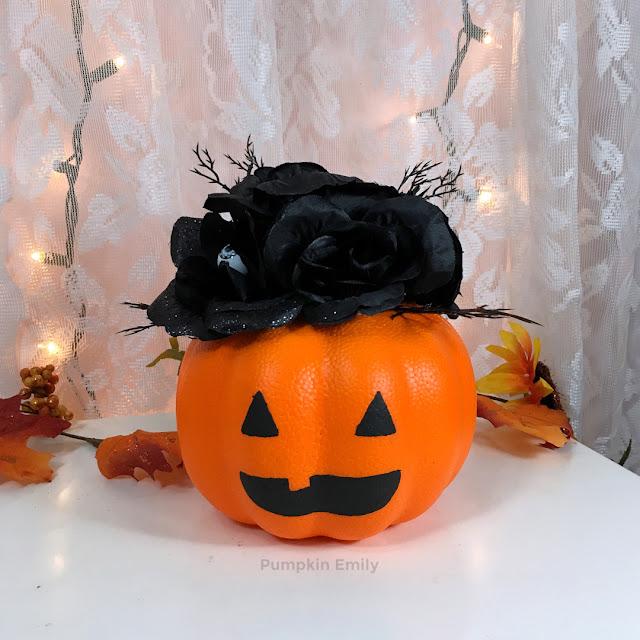 Jack o lantern pumpkin with flowers