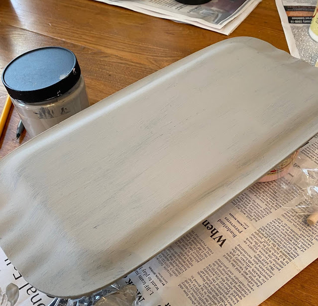 Photo of old tray being painted.