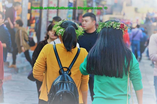 Girls wearing flower tiaras, Phoenix Fenghuang County, Hunan, China