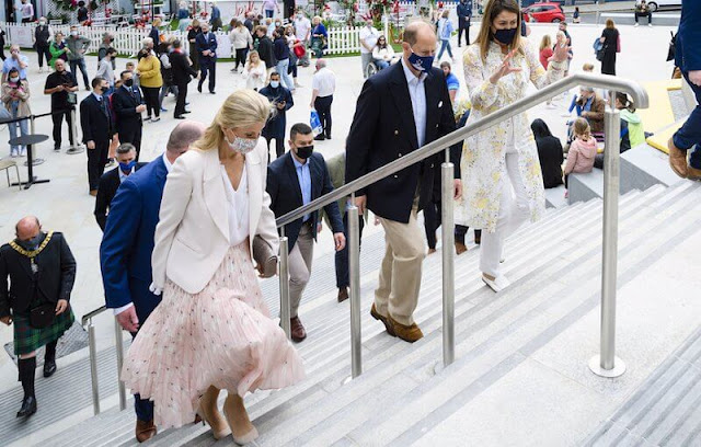 The Countess of Wessex wore a pleated silk midi skirt by Valentino. The Countess wore a pink skirt with white top and blazer