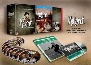 Opened box set showing discs and booklets