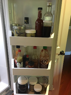Photo inside refrigerator door showing zero waste, plastic-free storage of vegan condiments. https://trimazing.com/