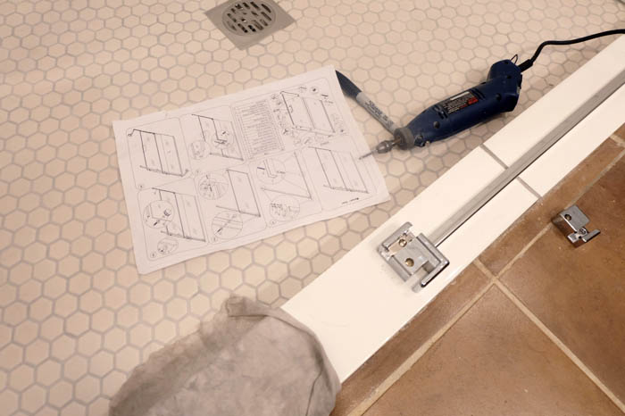 mapping out the glass shower door installation