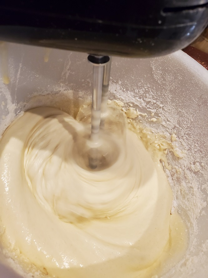 batter in vanilla flavor for making a texas sheet cake in a bowl with beaters