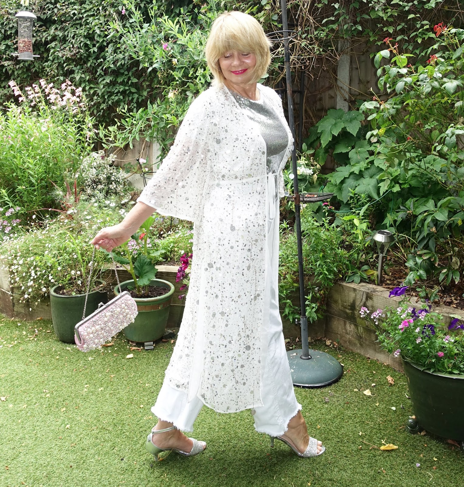 Wearing sequins and embellishments can be a very flattering look for the over 50s as metallics, like pearls, reflect back to the face and add a youthful glow. Is This Mutton, the fashion and beauty blog for the over 50s, shows how to create a show stopper summer outfit in white and silver.