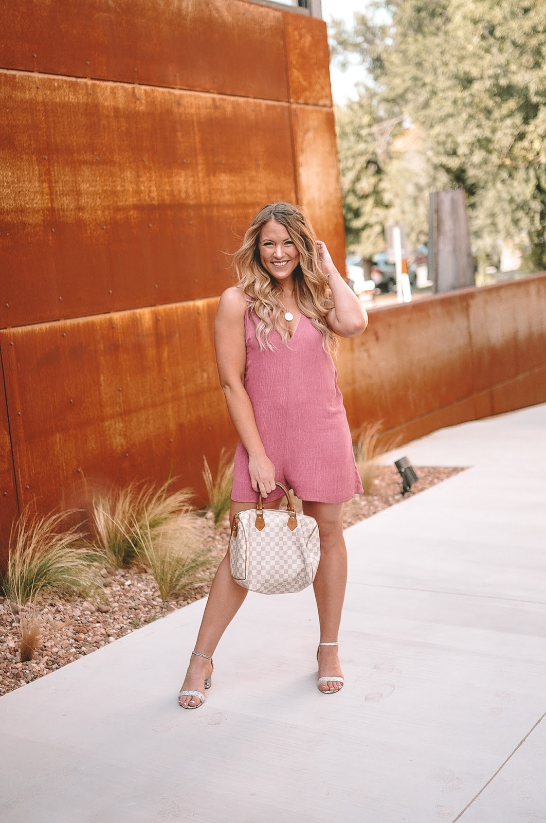 Amanda Martin of Amanda's OK Blog in OKC styles a pink romper from The Impeccable Pig
