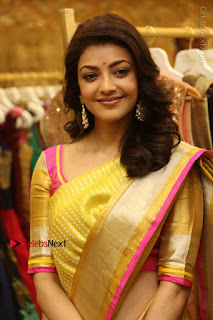 Actress Kajal Agarwal Stills in Golden Silk Saree at Trisha Sesigner Store Launch  0025.jpg