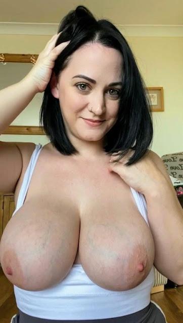 Topless Groovy amateur with juicy big tits naked