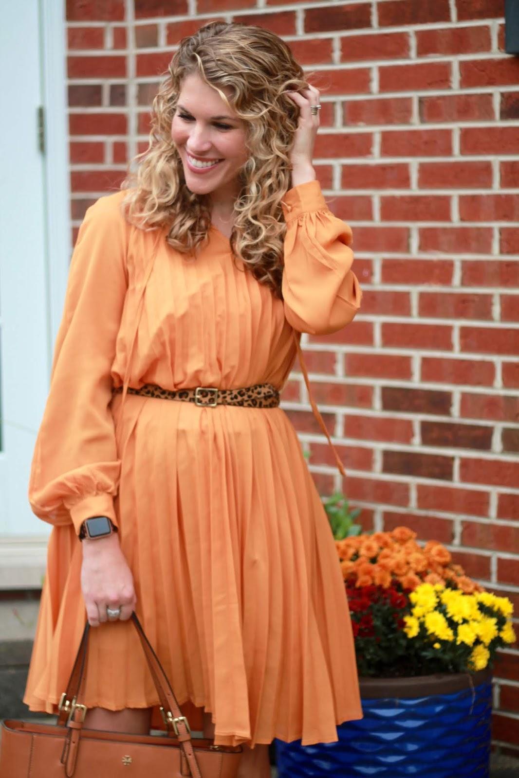 yellow pleated dress, burgundy heels, Tory Burch tote, leopard belt,