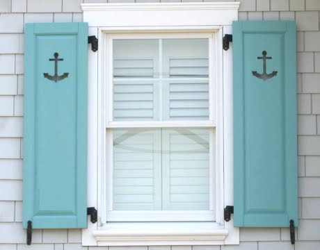 decorative window shutters with nautical cutouts